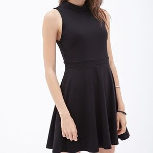 Mock-neck black sleeveless dress
